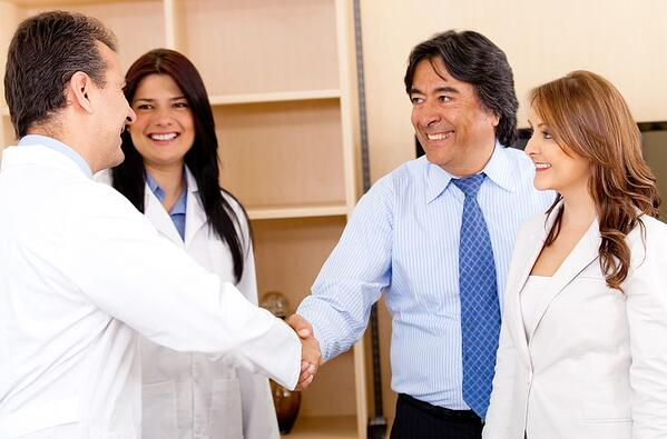 Business man handshaking with a doctor for making a successful sale