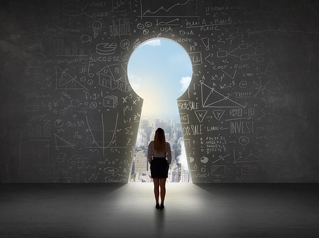 Business woman looking at keyhole with bright cityscape concept background-1